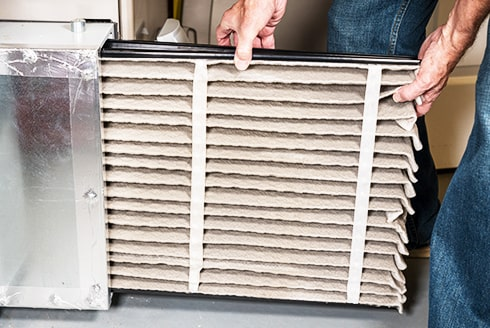 A technician replacing a heating system