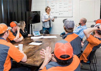 Quality Heating, Cooling & Plumbing staffs in a meeting - Glenpool, OK